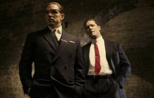 FIRST LOOK AT TOM HARDY AS THE KRAY TWINS AND AUSTRALIA'S EMILY BROWNING AS THE LEAD ACTRESS IN 'LEGEND'