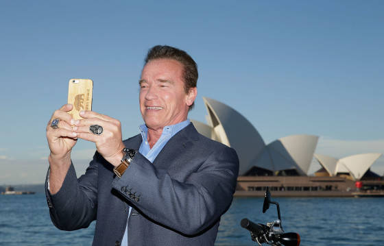SYDNEY, AUSTRALIA - JUNE 04:  Arnold Schwarzenegger takes a selfie during a 'Terminator Genisys' photo call at the Park Hyatt Sydney on June 4, 2015 in Sydney, Australia.  (Photo by Mark Metcalfe/Getty Images for Paramount Pictures International) *** Local Caption *** Arnold Schwarzenegger