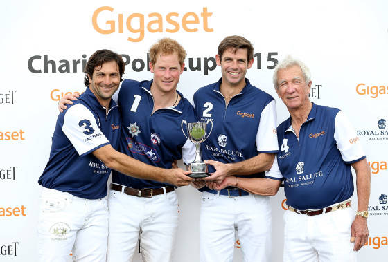 TETBURY, ENGLAND - JUNE 14:  Winning team Royal Salute, Eduardo Novillo Astrada, Prince Harry, Malcolm Borwick and Sir Charles Williams collect the winning trophy at the Gigaset Charity Polo Match at Beaufort Polo Club on June 14, 2015 in Tetbury, England.  (Photo by Chris Jackson/Getty Images for Gigaset Mobile) *** Local Caption *** Eduardo Novillo Astrada; Prince Harry; Malcolm Borwick; Sir Charles Williams