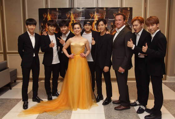 SEOUL, SOUTH KOREA - JULY 02:  Arnold Schwarzenegger and Emilia Clarke pose with South Korean Idol group BtoB during the Seoul Premiere of 'Terminator Genisys' at the Lotte World Tower Mall on July 2, 2015 in Seoul, South Korea.  (Photo by Chung Sung-Jun/Getty Images for Paramount Pictures International) *** Local Caption *** Emilia Clarke; Arnold Schwarzenegger; BtoB