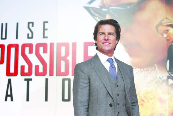Tom Cruise attends the UK Fan Screening of 'Mission: Impossible - Rogue Nation' at the IMAX Waterloo on July 25, 2015 in London, United Kingdom.