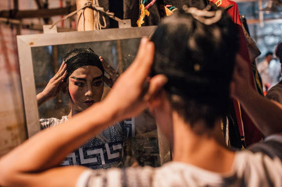 Performers prepare in backstage at a Chinese opera during the month of Hungry Ghost Festival (Yu Lan) on August 14, 2015 in Hong Kong. The Hungry Ghost Festival had been inscribed on to ChinaÕs third national list of intangible cultural heritage in 2011, is intrinsically linked to this Chinese practice of ancestor worship. The main activities for the festival includes paying respect to the ghosts, burning daily ware made with paper for the dead, opera for the spirits and bidding for lucky charm.