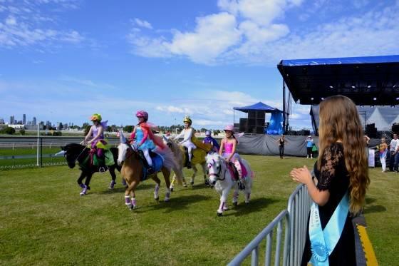 Miss Gold Coast Show teen Savannah Tindiglia cheering on the Unicorn Race!