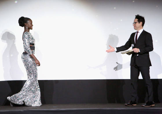 "HOLLYWOOD, CA - DECEMBER 14:  Actress Lupita Nyong'o (L) and director J.J. Abrams attends the World Premiere of ""Star Wars: The Force Awakens"" at the Dolby, El Capitan, and TCL Theatres on December 14, 2015 in Hollywood, California.  (Photo by Jesse Grant/Getty Images for Disney) *** Local Caption *** Lupita Nyong'o; J.J. Abrams"