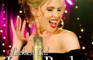 MUSIC REVIEWS …LUCY BURKE HUSH HUSH BIZ SINGLE REVIEW Luckiest Girl