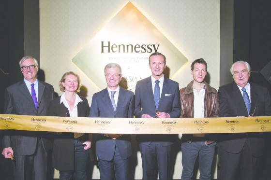 MOSCOW, RUSSIA - MAY 25:  Maurice Richard Hennessy, Olga Kisselova, Bernard Peillon, Francois  Xavier Desplancke, Laurent Pernot , Yann Fillioux pose at the ribbon cutting ceremony during the Hennessy 250 Tour at the New Manege on May 25, 2015 in Moscow, Russia.  (Photo by Victor Boyko/Getty Images)