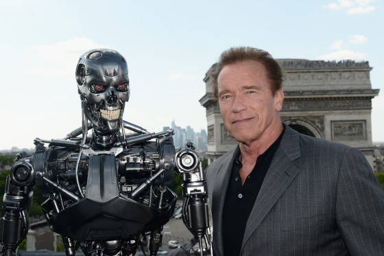 PARIS, FRANCE - JUNE 19:  Actor Arnold Schwarzenegger poses with Endoskeleton during the France Photocall of 'Terminator Genisys' at the Publicis Champs Elysees on June 19, 2015 in Paris, France.  (Photo by Dominique Charriau/Dominique Charriau/Getty Images for Paramount Pictures) *** Local Caption *** Arnold Schwarzenegger