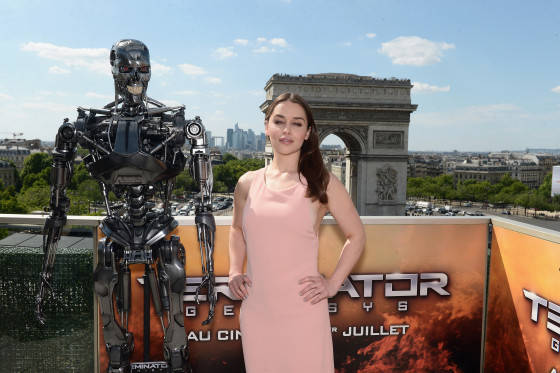 PARIS, FRANCE - JUNE 19:  Actress Emilia Clarke poses with Endoskeleton during the France Photocall of 'Terminator Genisys' at the Publicis Champs Elysees on June 19, 2015 in Paris, France.  (Photo by Dominique Charriau/Dominique Charriau/Getty Images for Paramount Pictures) *** Local Caption *** Emilia Clarke