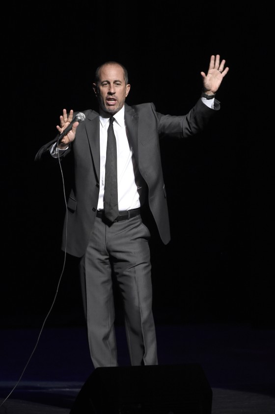 """NEW YORK, NY - NOVEMBER 16:  Comedian Jerry Seinfeld performs onstage as Baby Buggy celebrates 15 years with """"An Evening with Jerry Seinfeld and Amy Schumer"""" presented by Bank of America - Inside at Beacon Theatre on November 16, 2015 in New York City.  (Photo by Kevin Mazur/Getty Images for Baby Buggy)"""